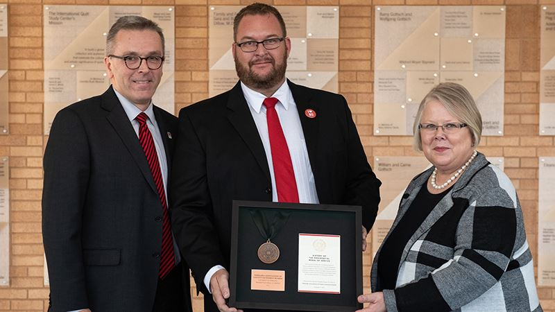 In 2019, NACEB was the recipient of the Presidential Medal of Service, an annual honor that celebrates Nebraskans' support and advocacy for the NU system. NACEB President Steve Stettner (middle) accepted the award from University of Nebraska Lincoln Chancellor Ronnie Green (left) and University of Nebraska Interim President Susan Fritz (right).